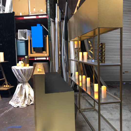 Gold shelving shown behind bar