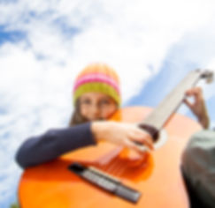 Little girl playing guitar outdoor.jpg