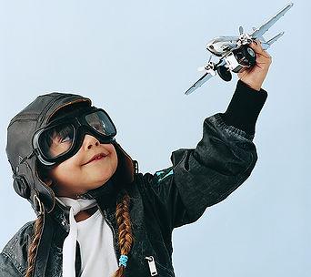Aspiring Pilot wih toy plane.