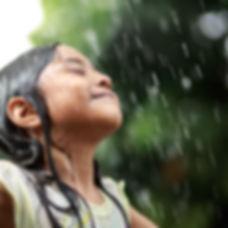 Closeup little girl in the summer rain.j