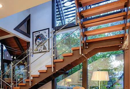Vogue Homes Master Stair Builders Created This Staircase Utilizing A  Combination Of Wood, Metal Risers, And Stainless Metal Railing Make A  Harmonious ...