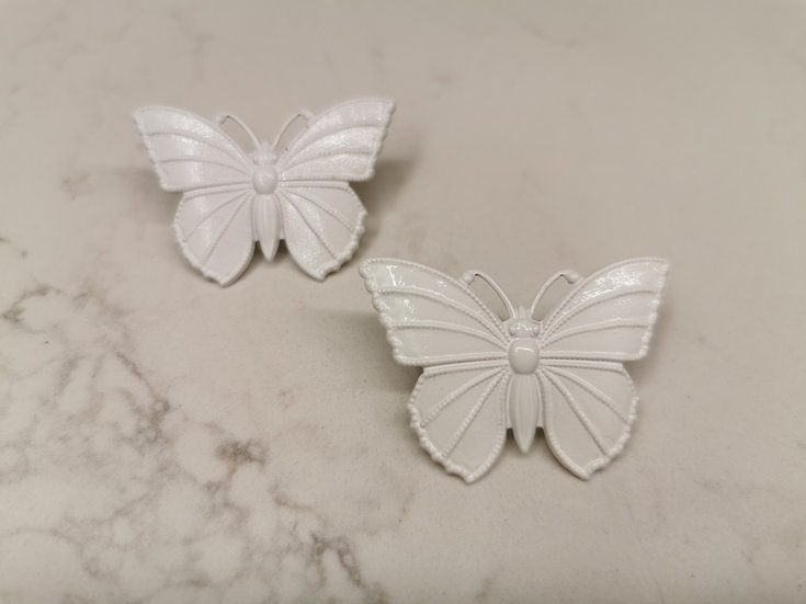 White butterfly effect studs