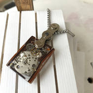 STEAMPUNK SMALL RECTANGLE RESIN AND LEATHER PENDANT