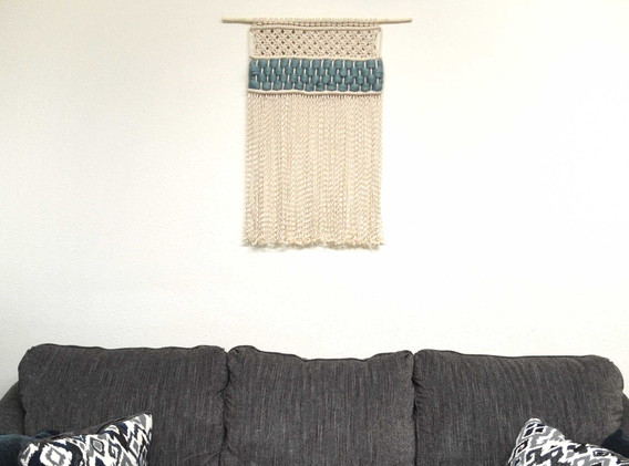 macrame wall hanging with aqua roving