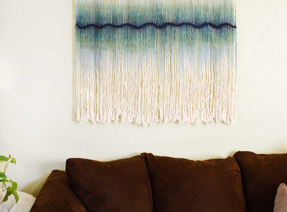 cream and blue wall hanging