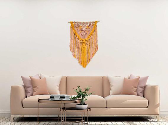pink and tangerine macrame wall hanging