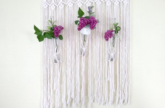 lacy piece with three vases