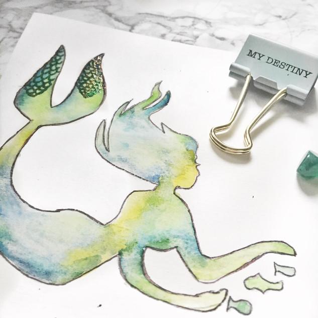 mermaid on watercolor pad.jpg