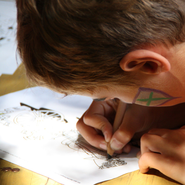 boy coloring with black pen - replace pe