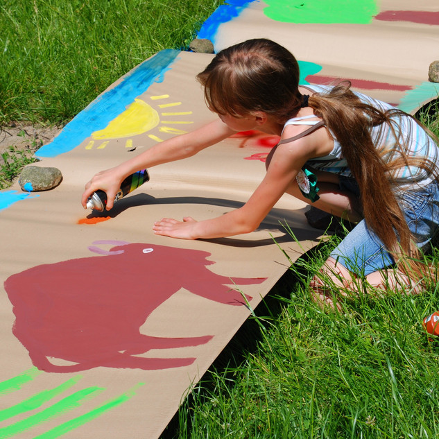young girl spray painting square.jpg