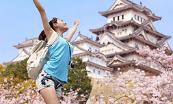 Happy Travel Woman With Sakura Tree_edited.jpg