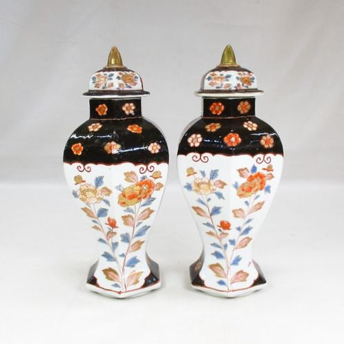 A pair of late 17th century Imari porcelain vases & covers.