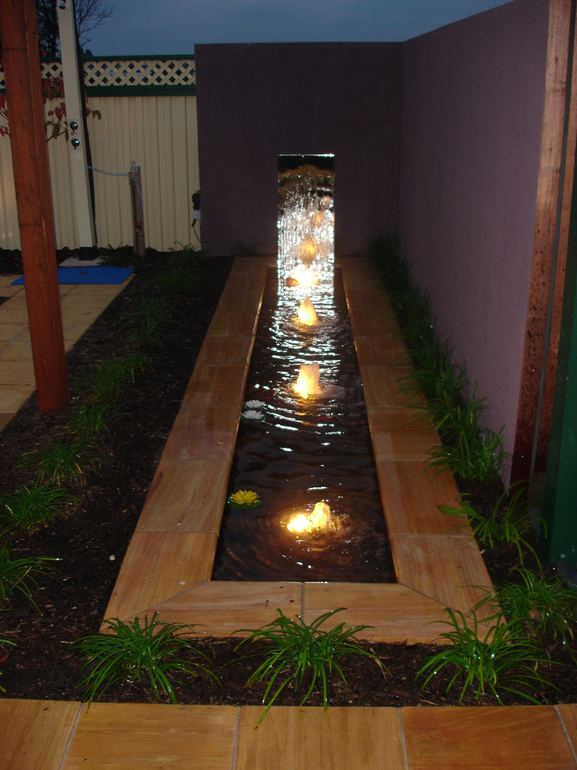 Water feature,paving & planting