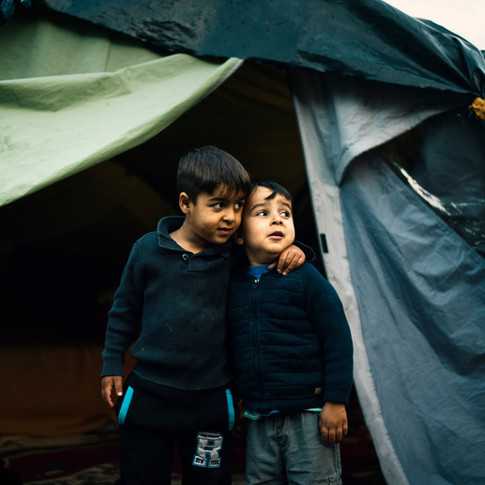 Brothers in a migrant camp, Strasbourg