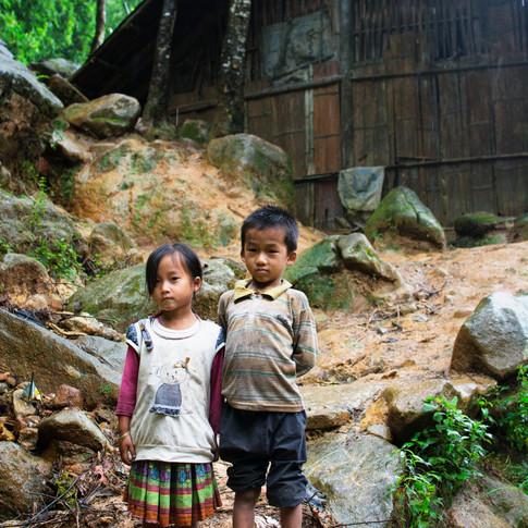 Vietnamese kids in front of their house, Northern Vietnam