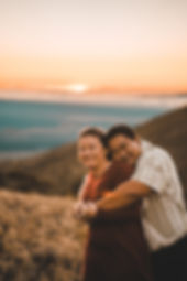 couple hugging sunset engagement
