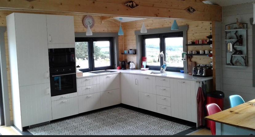 White kitchen in a log cabin