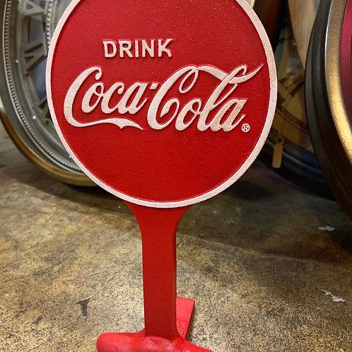 Coke door stop