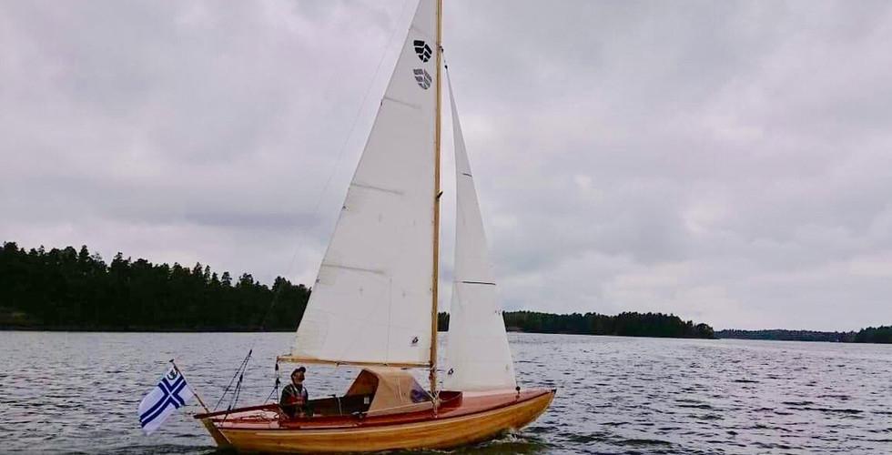 Sailing with sprayhood up.