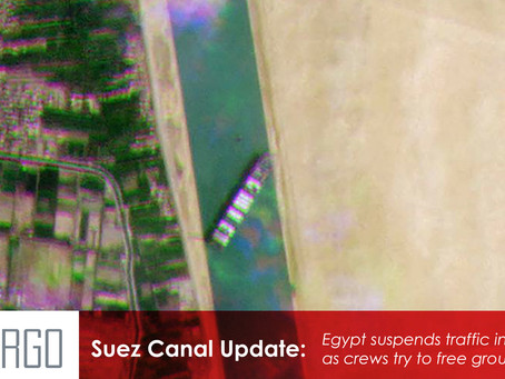 Egypt suspends traffic in Suez Canal as crews try to free grounded ship