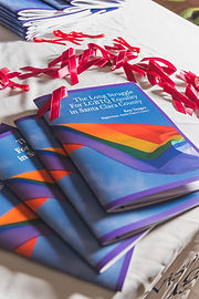 lgbtq history booklets fanned on table