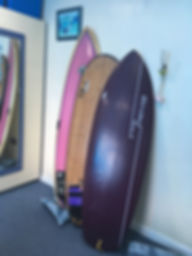 My current quiver of surfboards, from left to right, Beach Beat shortboard, Tiki Bamboo board and JP Blinded Soul board
