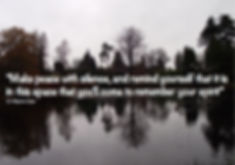 Picture of a lake lined by trees and showing the reflection of those trees in the water, quote reads make peace with silence, and remind yourself that it is in this space that you'll come to remember your spirit, Dr Wayne Dyer.