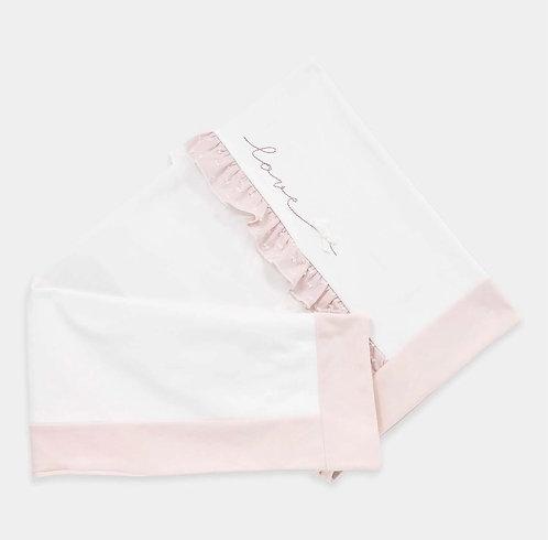Coperta in felpa bianca e rosa antico