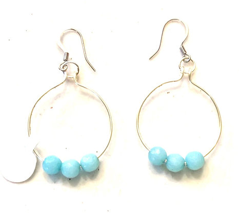 Silver hoops with blue beads