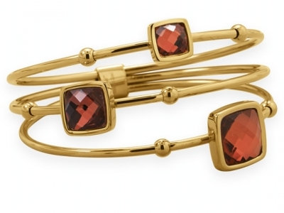 Multi gold bangle with red stones