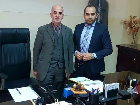 إتفاقية تعاون بين السفير رامي العطار و القاضي حسن الحاج شحادة