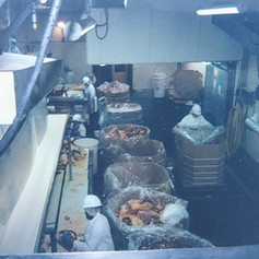 Boning operations, note the filling of combo bins with finished product, 1999