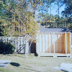 The walls of my shed are going up, 1992.  I had accommodated the neighbor's suggestion to alter the property line.