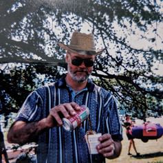 Pouring a coke at a family outing, June 2000