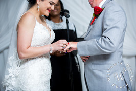 Ring exchange at the altar.