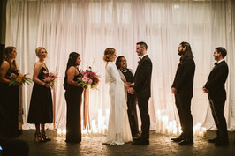 white drapery wedding altar