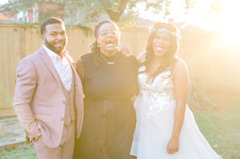 black wedding officiant and couple