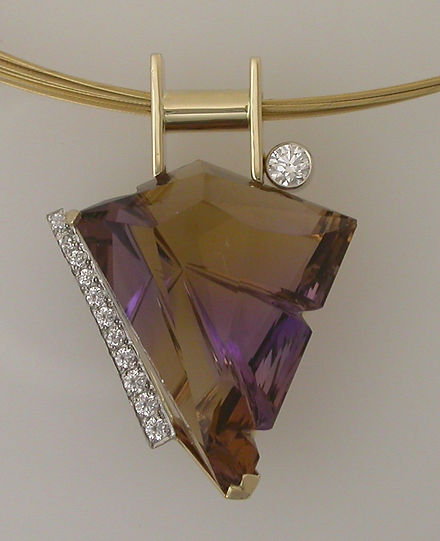 Fancy Cut Ametrine with Diamonds in 14k yellowgold