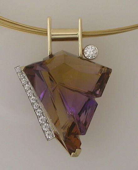 Fancy Cut Ametrine with Diamonds in 14k yellowgold