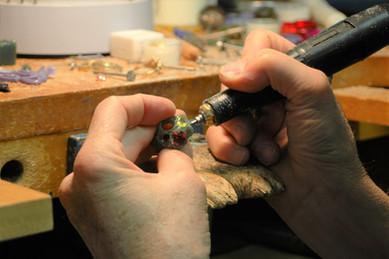 Bill fitting stones in wax.