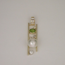 Completed peridot and pearl pendant