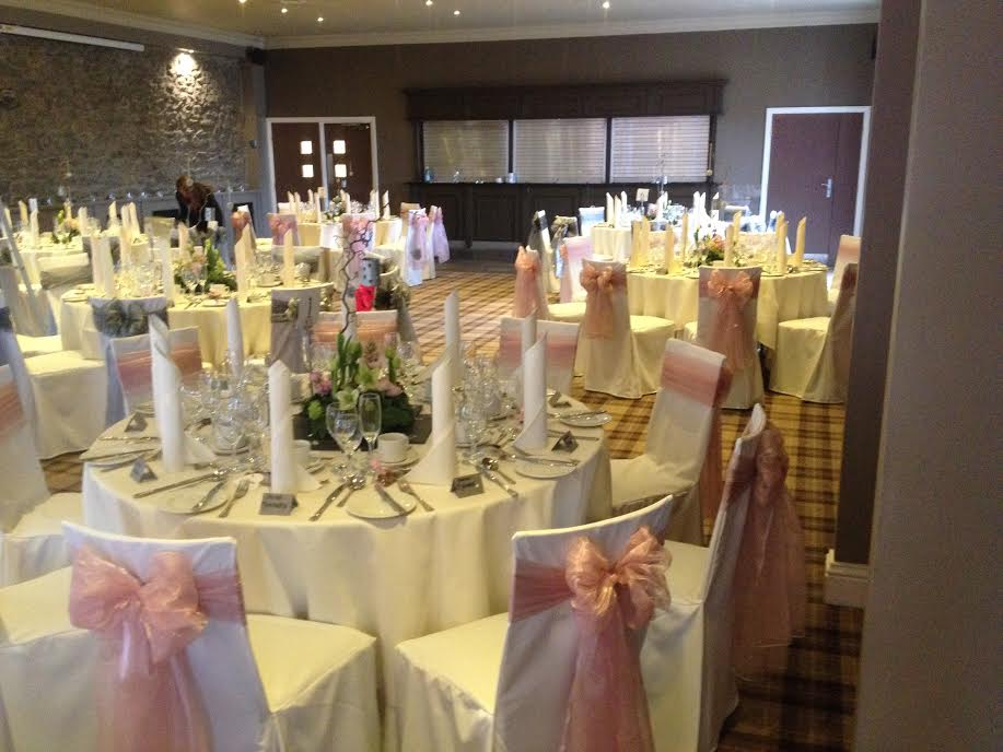 dusky pink organza bowed sashes at The Coniston