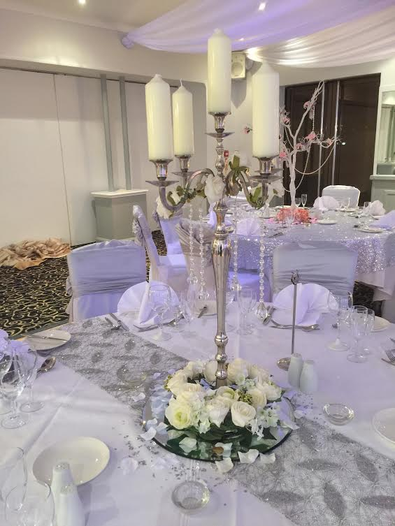 Silver candelabra with ivory roses and crystals