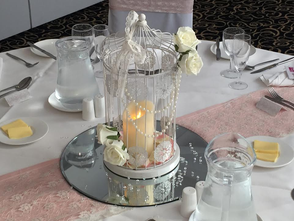birdcage with pearls and ivory roses