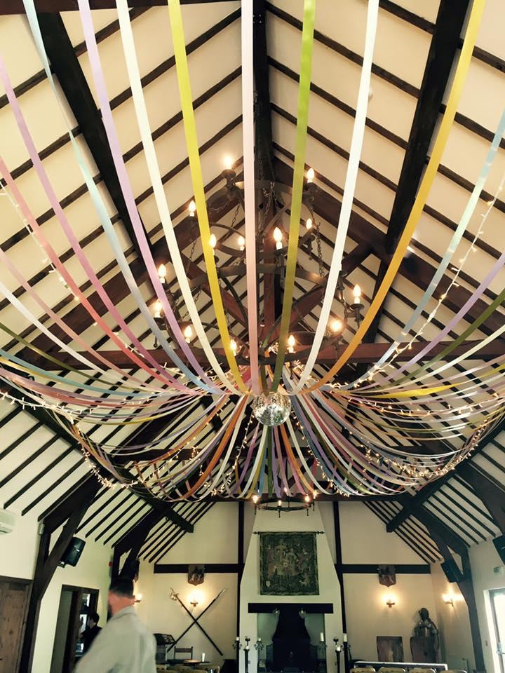 coloured ribbon ceiling drapes