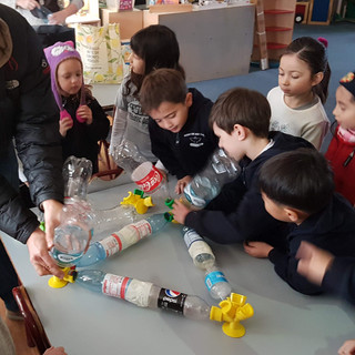 These students love to build. Today they began working on a chair out of recycled bottles for their classroom!