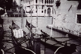 Black and White film shot of Venetian Gondolas in the Grand Canal, Venice, Italy