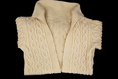 Knit white sweater jacket with classic pattern, no buttons, fold collar