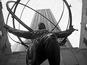 Black and white pic of the Hurcules statue in Rockafeller Center with textured background