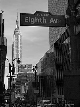 Black and White pic of 8th Ave sign with Empire State in background
